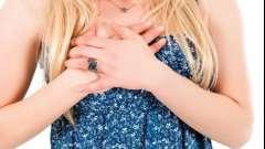 Чому перед місячними сильно болить груди?